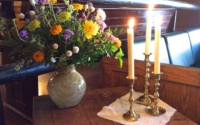 Vintage Candle Holders with Flowers on Table