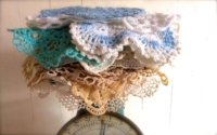 Vintage Stack of Doilies on Vintage Scale