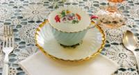 Vintage Tea Napkin under Vintage Teacup