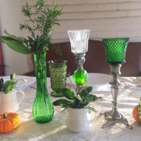 Green and Clear Peg Holders on Table