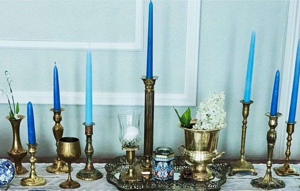 Assorted Brass Candleholders with Blue Candles